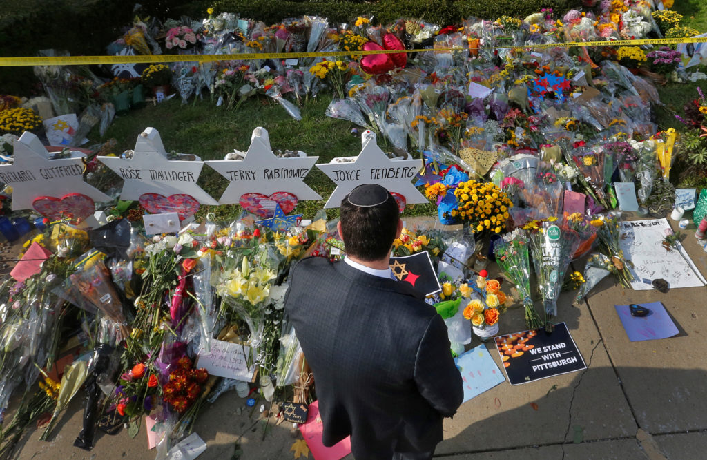 A man prays at a makeshift memorial outside the Tree of Life synagogue following Saturday's shooting at the synagogue in Pittsburgh, Pennsylvania, U.S., October 31, 2018. Photo by Cathal McNaughton/Reuters