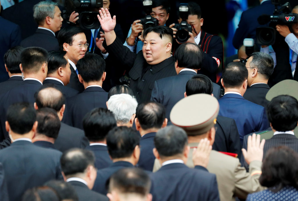 North Korean leader Kim Jong Un bids farewell to the crowd before boarding his train to depart for North Korea at Dong Dan...