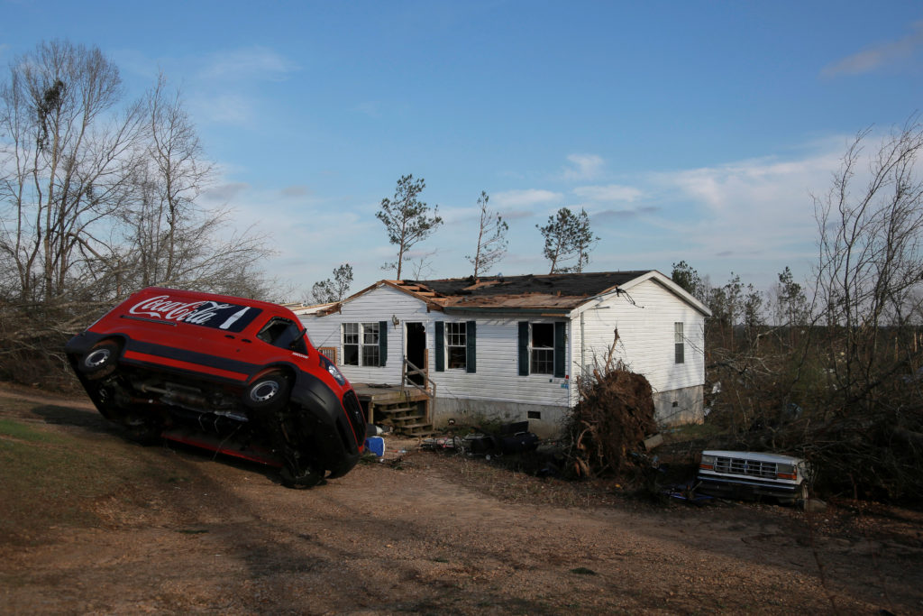 A Coca-Cola truck is seen tipped over on its side after two deadly back-to-back tornadoes, in Beauregard, Alabama, U.S., March 4, 2019. Photo by REUTERS/Elijah Nouvelage