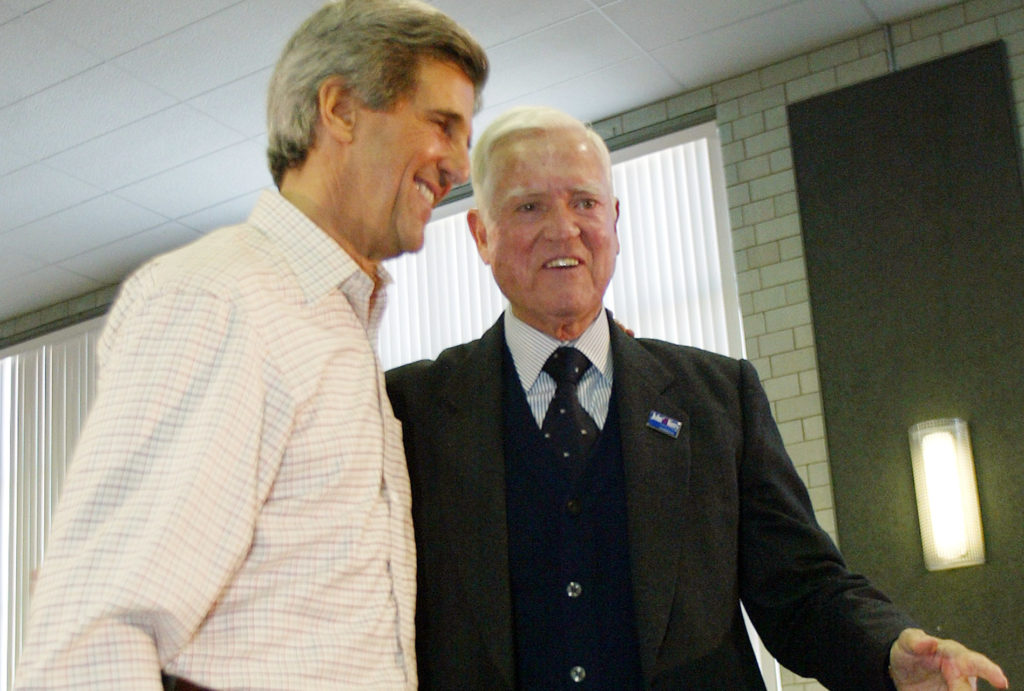 U.S. Democratic presidential candidate Massachusetts Senator John Kerry stands with South Carolina Senator Fritz Hollings during a Town Hall meeting with fellow veterans in Manchester, New Hampshire, January 23, 2004. Hollings endorsed Kerry's candidacy at the meeting. Kerry currently leads in the polls for the January 27, New Hampshire Democratic presidential primary election. Photo by Mike Segar MS/JDP/Reuters