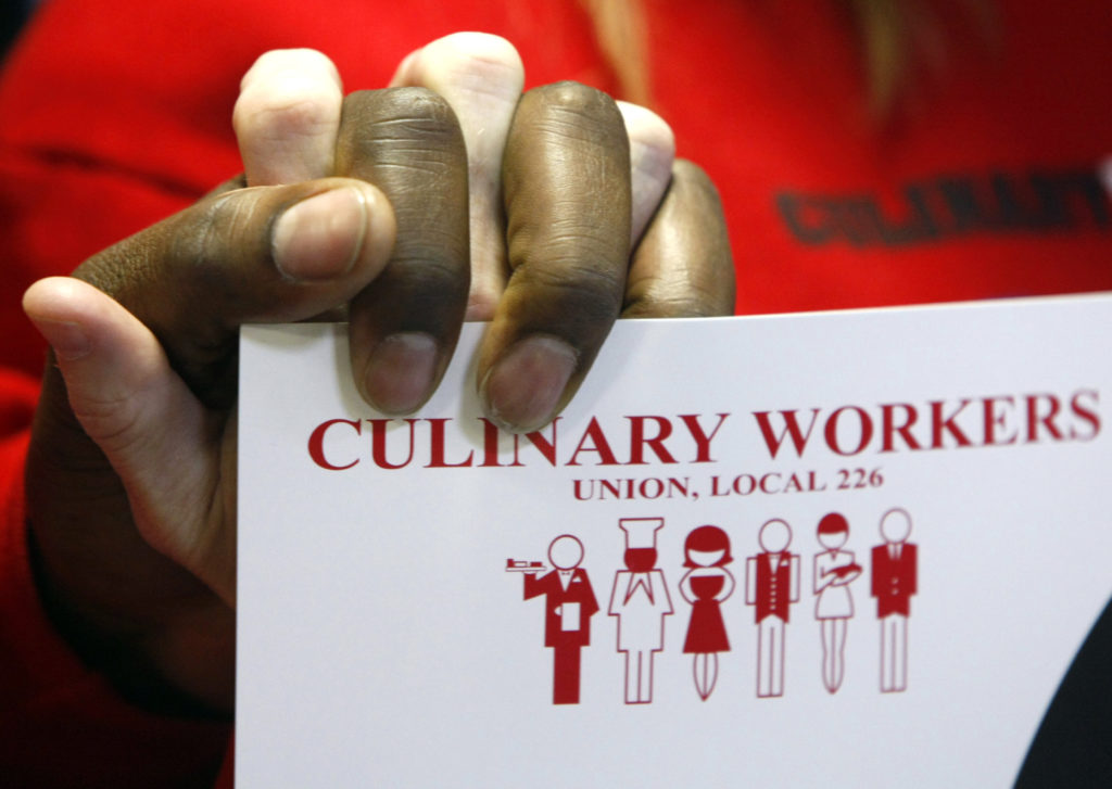 Members of the Culinary Workers Union, Local 226 join hands at the 2008 announcement of the union's endorsement of then Sen. Barack Obama, D-Ill., for president in Las Vegas. Photo by Rick Wilking/Reuters