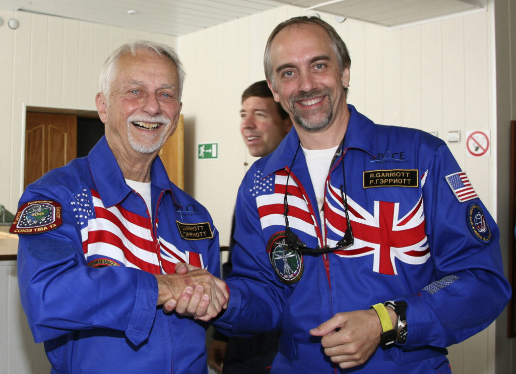 U.S. space tourist Richard Garriott (right) and his father former NASA astronaut Owen Garriott (left) pose for a picture at Baikonur Cosmodrome in Kazakhstan on October 8, 2008. Photo by Sergei Remezov/Reuters