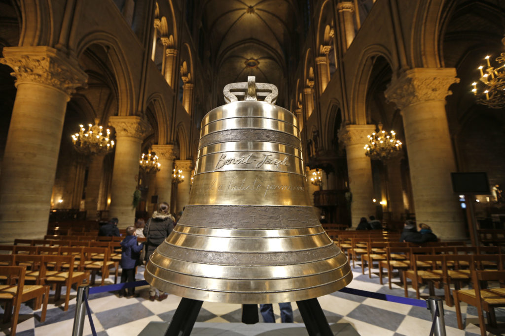 The bell 'Benoit Joseph', dedicated to Pope Benedict XVI, is displayed with the seven other replacement bells and the bourdon in the nave of Notre-Dame de Paris Cathedral in Paris on February 12, 2013. The new eight bronze bells were cast with medieval methods at a French foundry in Normandy. The new bells have the same weight and diameter as the ones from the 18th-century which were melted down and turned into cannons during the French Revolution, and are designed to produce the same sound.   Photo by Charles Platiau/Reuters