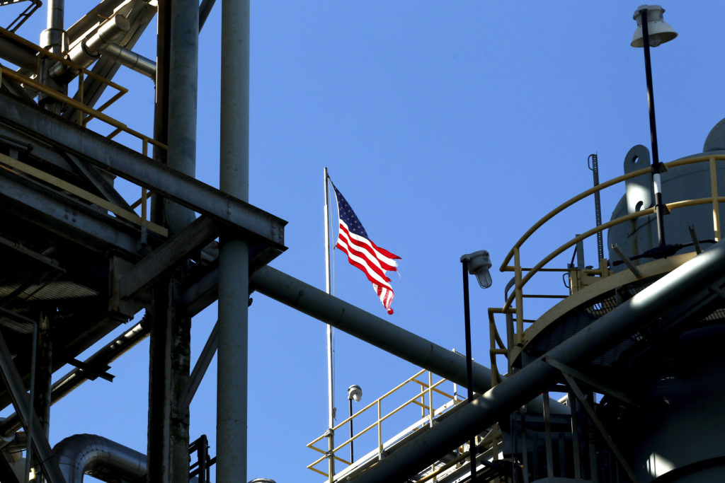 A U.S. flag is seen at full mast atop a polyurethane plant in Geismar, Louisiana. GDP growth in the first quarter of 2019 was driven in part by increased business investment. Photo by Jonathan Bachman/Reuters