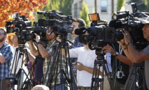 Television media cover a news conference about a mass shooting in Roseburg. Photo by REUTERS/Steve Dipaola