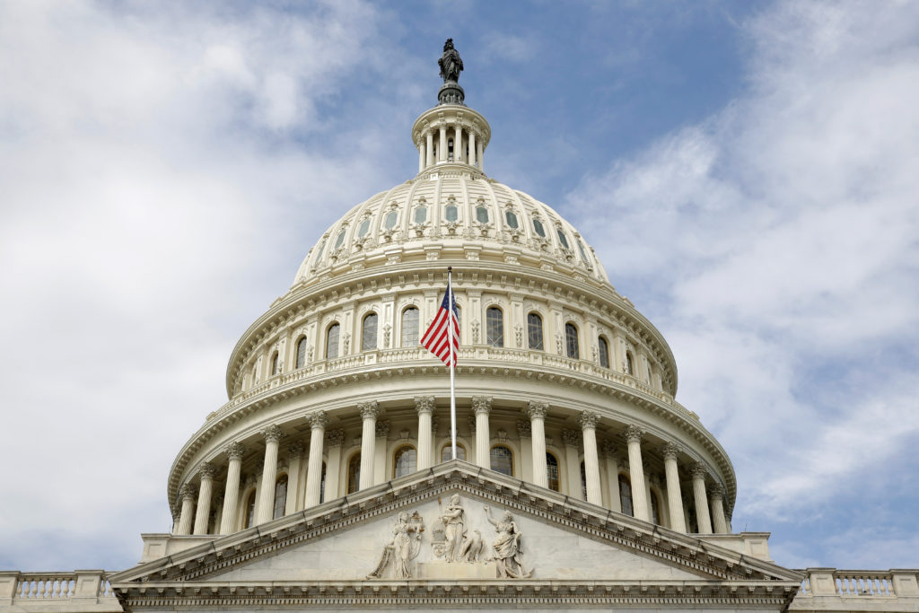 The U.S. flag flies in front of the Capitol Dome at the U.S. Capitol in Washington, U.S., September 12, 2017. File photo b...