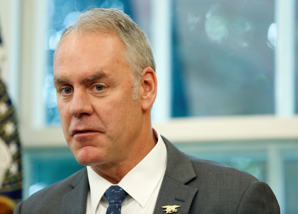 "Then-Secretary of Interior Ryan Zinke speaks during an event hosted by President Donald Trump with workers on ""Cutting the Red Tape, Unleashing Economic Freedom"" in the Oval Office of the White House in Washington, on October 17, 2018. Photo by Joshua Roberts/Reuters"
