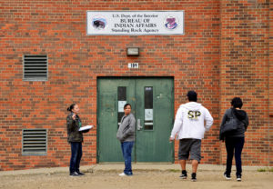 Voting canvasser, Desiree McArdel (left) helping tribal members obtain proper identification cards from the Bureau of Indian Affairs ahead of the 2018 mid-term elections on the Standing Rock Reservation in Fort Yates, North Dakota, on October 26, 2018. Photo by Dan Koeck/Reuters