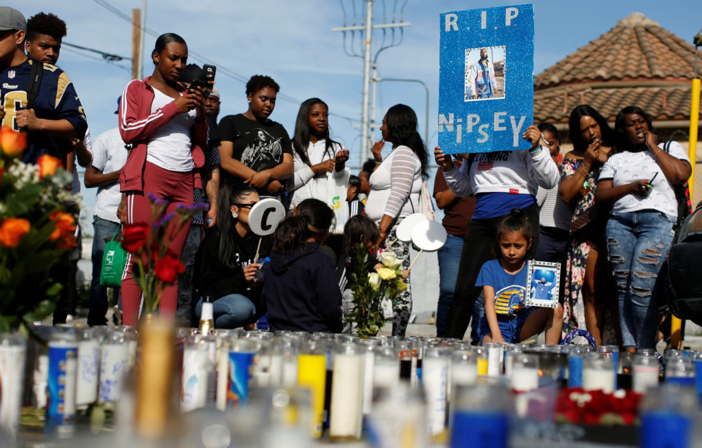 People gather around a makeshift memorial for Grammy-nominated rapper Nipsey Hussle who was shot and killed outside his clothing store in Los Angeles, California. Photo by Mario Anzuoni/Reuters