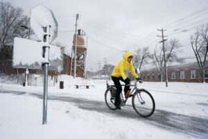 A bicyclist exits the Midtown Greenway bicycle and pedestrian trail during the spring snowstorm in Minneapolis, Minnesota, U.S., April 11, 2019. Photo by Annabelle Marcovici/Reuters