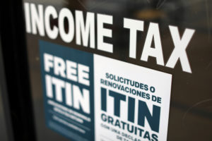 A tax sign is pictured on an H&R Block tax office in Los Angeles, California on April 26, 2017. Photo by Mike Blake/Reuters
