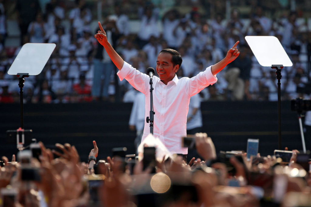 Indonesia's incumbent presidential candidate Joko Widodo gestures as he greets his supporters during a campaign rally at Gelora Bung Karno stadium in Jakarta, Indonesia, on April 13, 2019. Photo by Willy Kurniawan/Reuters