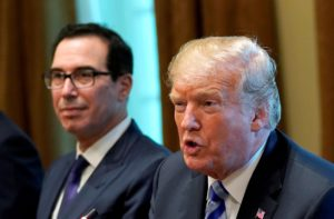 File photo of President Donald Trump seated with Treasury Secretary Steve Mnuchin during his meeting at the White House on Sept. 5, 2018. Photo by Kevin Lamarque/Reuters