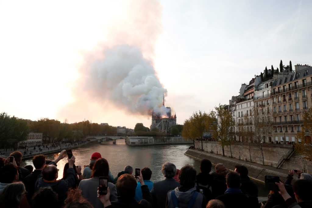 Smoke billows from Notre Dame Cathedral after a fire broke out, in Paris, France April 15, 2019. Photo by Benoit Tessier/Reuters