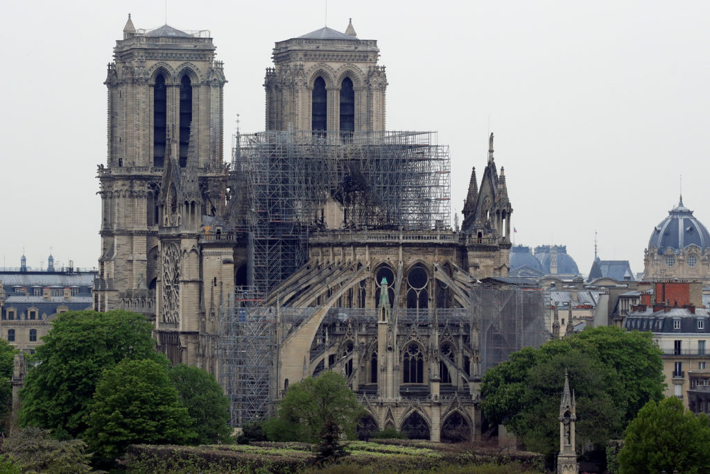 A view shows Notre-Dame Cathedral after a massive fire devastated large parts of the gothic gem in Paris, France, April 16, 2019.   Photo by Gonzalo Fuentes/Reuters