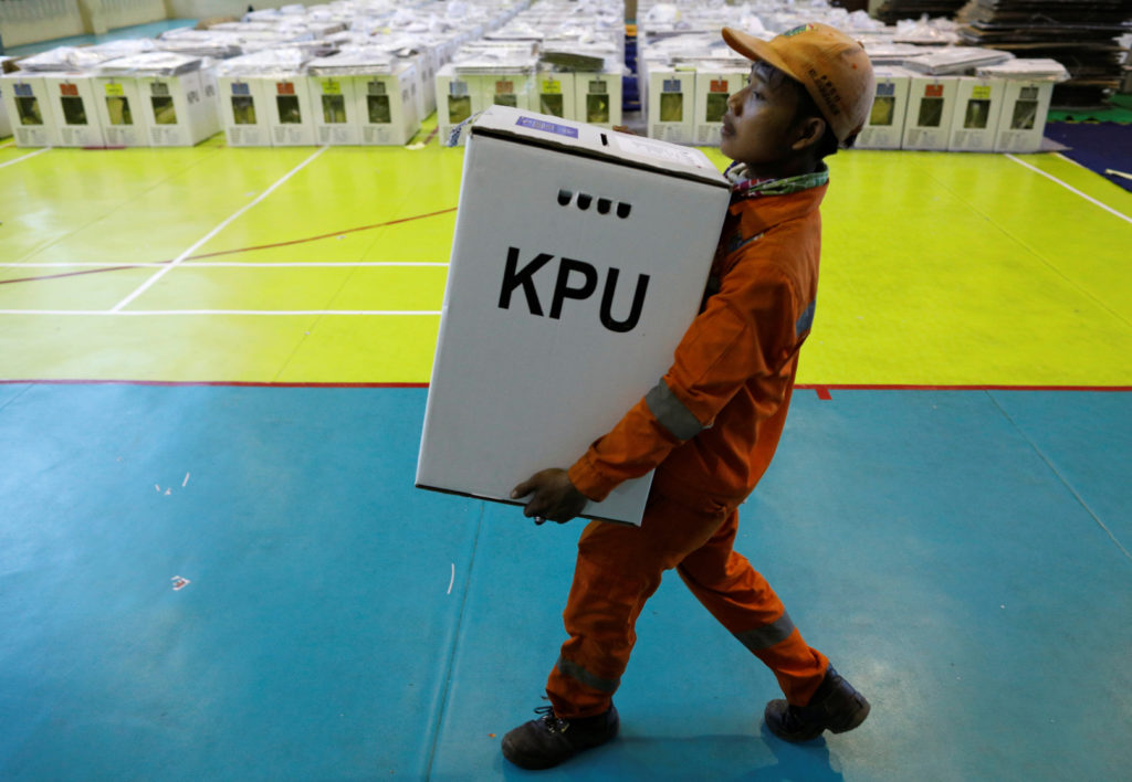 A worker prepares election materials to be distributed to polling s…