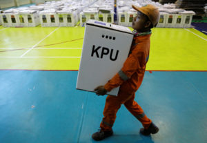 A worker prepares election materials to be distributed to polling stations at a sports hall in Jakarta, Indonesia on April 16, 2019. Nearly 193 million Indonesians are eligible to vote in presidential and legislative elections on Wednesday. Photo by Edgar Su/Reuters