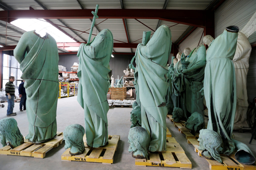 Statues that were removed from the spire of Paris' Notre-Dame Cathedral are seen in a workshop at the Socra company for restoration work in Marsac-sur-L'Isle, France, France. Photo by Regis Duvignau/Reuters