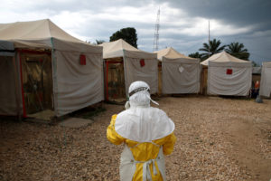 A health worker wearing Ebola protection gear, walks before entering the Biosecure Emergency Care Unit (CUBE) at the ALIMA (The Alliance for International Medical Action) Ebola treatment centre in Beni, in the Democratic Republic of Congo, March 30, 2019. Photo by Baz Ratner/Reuters