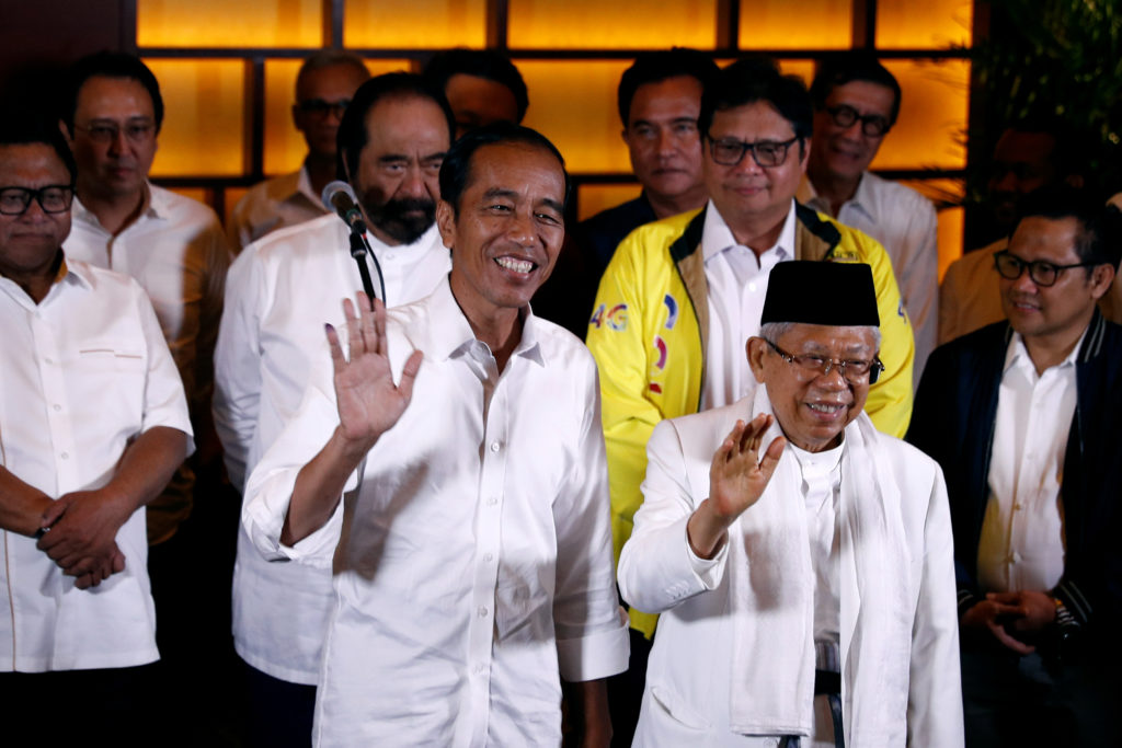 Indonesia's President Joko Widodo (left) and his running mate Ma'ruf Amin react after a quick count result during the Indonesian elections in Jakarta, Indonesia, April 17, 2019. Photo by Edgar Su/Reuters