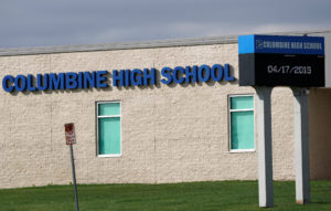 "The digital sign is pictured outside Columbine high school as some Denver area schools have closed while police search for an armed woman ""infatuated"" with Columbine, days ahead of the school shooting's 20th anniversary, in Littleton, Colorado. Photo by Rick Wilking/Reuters"