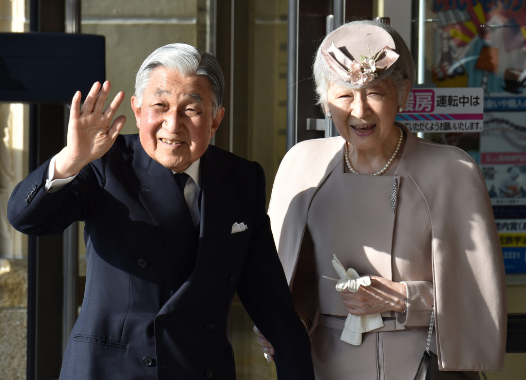 Japan's Emperor Akihito, accompanied by Empress Michiko, waves to well-wishers before leaving Ujiyamada Station after their visit to Ise Jingu shrine in Ise in the central Japanese prefecture of Mie, on April 18, 2019, as he takes part in a series of rituals ahead of his abdication. Kazuhiro Nogi/Pool via Reuters