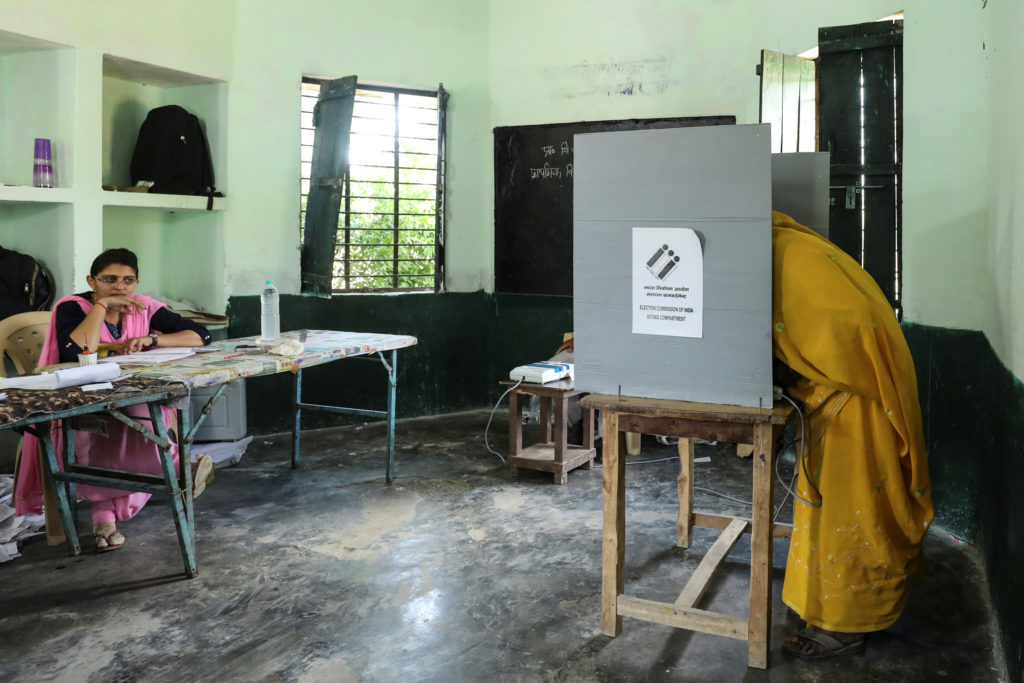 A woman casts her vote at a polling station during the second phase…