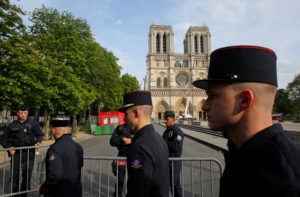 Members of Paris Fire Brigade enter the security perimeter to Notre Dame cathedral in Paris, France on April 18, 2019. Photo by Michel Euler/Pool via Reuters