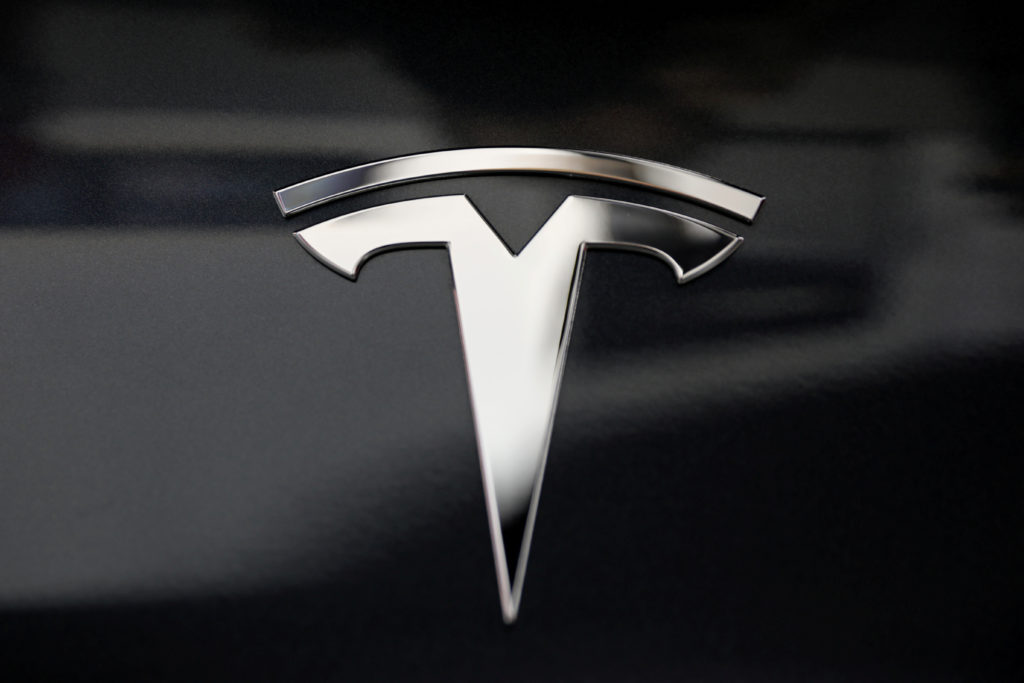 A Tesla logo is seen in Los Angeles, California. Telsa is showing off its latest technology to investors Monday. Photo by Lucy Nicholson/Reuters