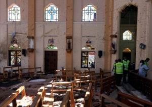 Police officers work at the scene at St. Sebastian Catholic Church, after bomb blasts ripped through churches and luxury hotels on Easter, in Negombo, Sri Lanka on April 22, 2019. Photo by Athit Perawongmetha/Reuters