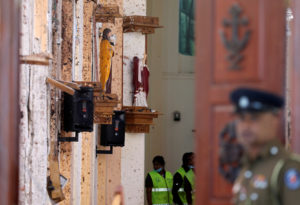 Police officers work at the scene at St. Sebastian Catholic Church, after bomb blasts ripped through churches and luxury hotels on Easter, in Negombo, Sri Lanka. Photo by Athit Perawongmetha/Reuters