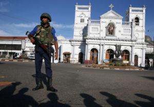 A security officer stands in front of St Anthony's shrine in Colombo, after bomb blasts ripped through churches and luxury hotels on Easter, in Sri Lanka. Photo by Athit Perawongmetha/Reuters