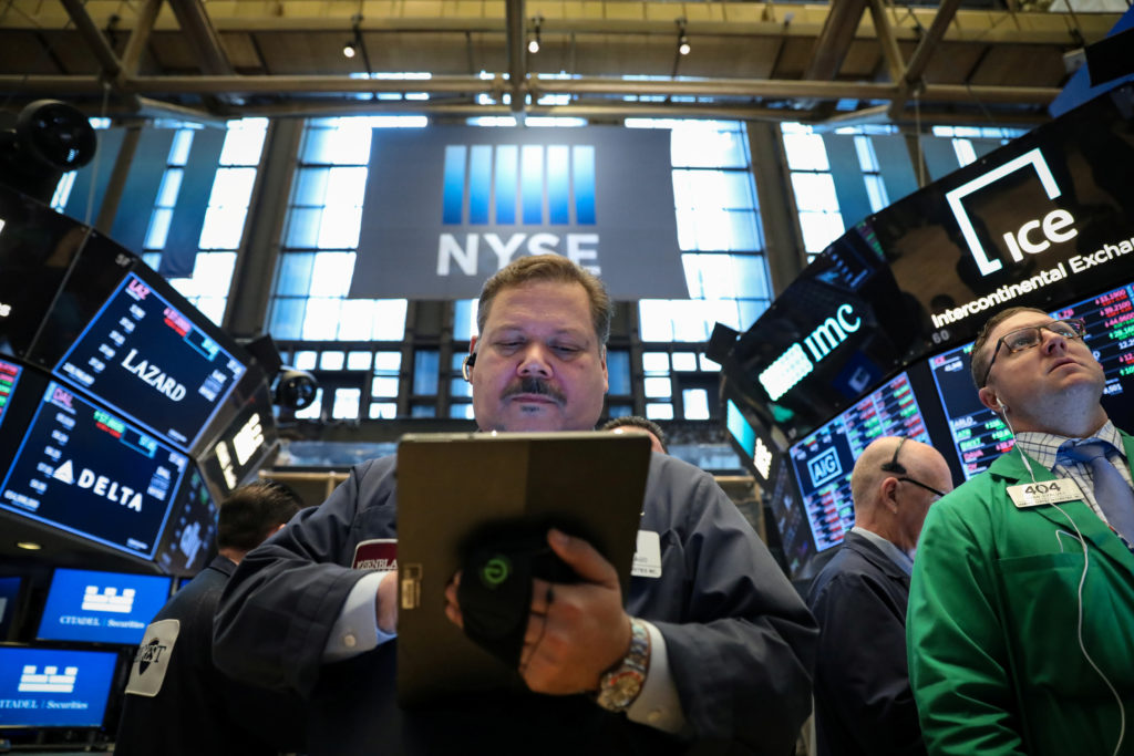 Traders work on the floor at the New York Stock Exchange on April 24, 2019. The S&P 500 hit a new record Tuesday. Photo by Brendan McDermid/Reuters