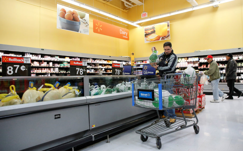A customer shops at a Walmart store in Chicago, Illinois, on November 20, 2018. Consumer spending has been lackluster in recent months but spiked in March. Photo by Kamil Krzaczynski/Reuters