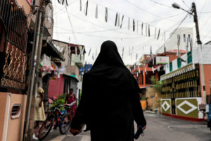 A Muslim woman wearing a hijab walks through a street near St Anthony's Shrine, days after a string of suicide bomb attacks across the island on Easter Sunday, in Colombo, Sri Lanka. Photo by Danish Siddiqui/Reuters