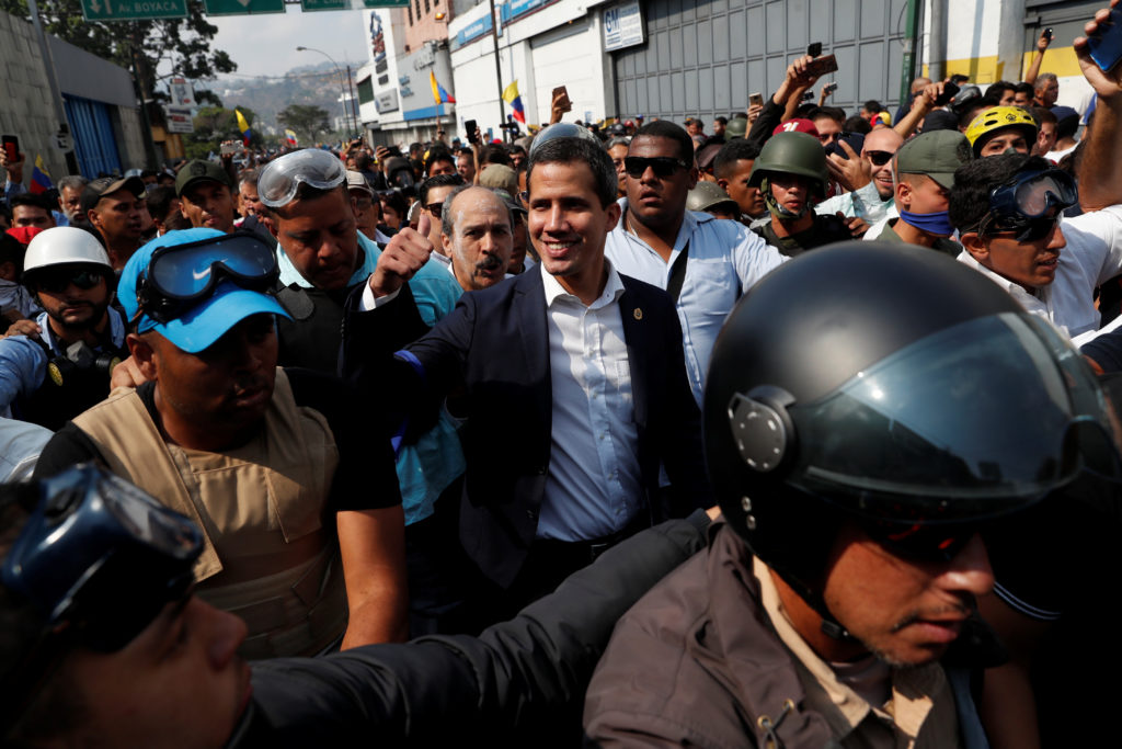 Venezuelan opposition leader Juan Guaido, who many nations have recognized as the country's rightful interim ruler, gestur...