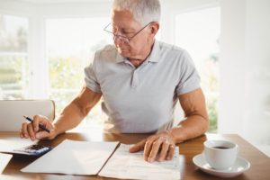 Worried senior man with tax documents