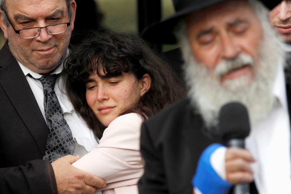 Howard Kaye holds his daughter Hannah Jacqueline Kaye at the funeral for Lori Gilbert-Kaye, the sole fatality of the Satur...