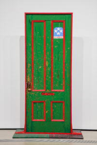 """Fred Hampton's Door 2,"" 1974, by Dana Chandler. Chandler's first version, a painting of a door riddled with bullets, was lost sometime after its creation in 1970. Photo by Pablo Enriquez"