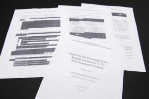 Media films a few pages of special counsel Robert Mueller's report on Russian interference in the 2016 election which was printed out by staff in the House Judiciary Committee's hearing room. Photo by Tom Williams/CQ Roll Call