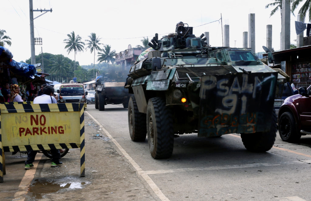 Armoured Personnel Carrier (APC) drives along a highway of Saguiaran, after President Rodrigo Duterte announced the liberation of Marawi city on Monday, in Lanao Del Sur, southern Philippines, October 28, 2017. Photo by Romeo Ranoco/Reuters