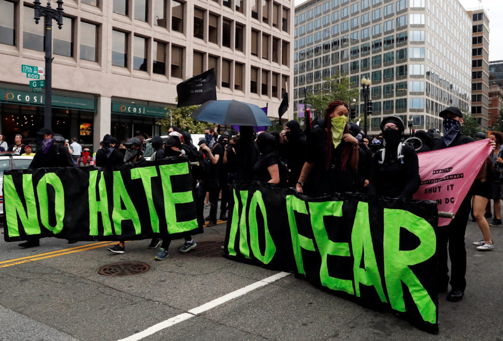 "Antifa, opponents of white nationalist, holds banners during a rally, marking the one year anniversary of the 2017 Charlottesville ""Unite the Right"" protests in Washington, August 12, 2018. Witnesses Republicans invited to the House committee hearing argued Antifa were to blame for violent incidents and criticized what they described as an attempt by universities to crack down on right-wing speech. Photo by Leah Millis/Reuters"