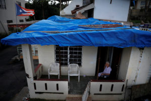 Lucila Cabrera, 86, sits at the porch of her house covered by plastic tarps over a damaged roof by Hurricane Maria, a year after the storm devastated Puerto Rico, near Barceloneta, Puerto Rico. Picture taken September 18, 2018. Photo by Carlos Barria/Reuters