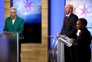 Fox 32 Chicago moderator Mike Flannery (center) and Chicago mayoral election candidates Toni Preckwinkle (left) and Lori Lightfoot (right) appear during a recorded forum in Chicago on March 26, 2019. Photo by Joshua Lott/Reuters