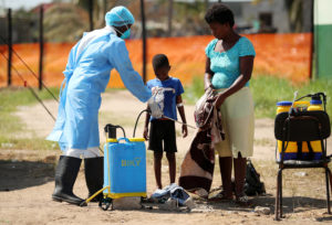 Medical staff spray disinfectant at a cholera treatment centre set up in the aftermath of Cyclone Idai in Beira, Mozambique, March 29, 2019. Photo by Mike Hutchings/Reuters