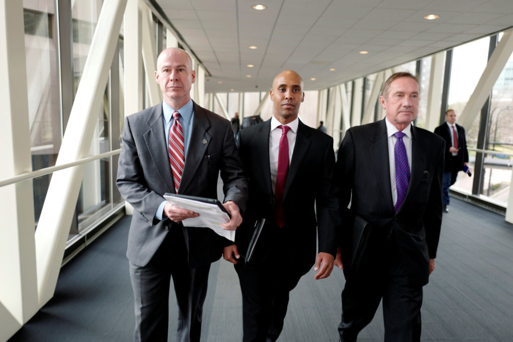 Mohamed Noor and attorneys Peter Wold and Thomas Plunkett exit the courthouse during the first day of the murder trial of former Minneapolis police officer Mohamed Noor, charged in the 2017 with fatal shooting of 40-year-old Australian woman Justine Ruszczyk Damond, in Minneapolis, Minnesota, U.S., April 1, 2019. Photo by Adam Bettcher/Reuters