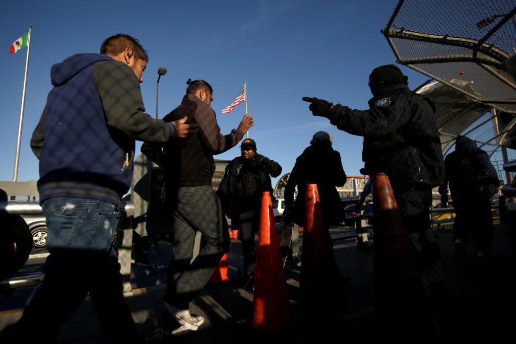 Commuters show their Visa cards to U.S. Customs and Border Protection agents to cross into El Paso, Texas, at Paso del Norte international border crossing bridge, in Ciudad Juarez, Mexico April 1, 2019. Photo by Jose Luis Gonzalez/Reuters
