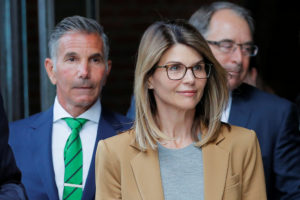 Actor Lori Loughlin, and her husband, fashion designer Mossimo Giannulli, leave the federal courthouse after facing charges in a nationwide college admissions cheating scheme, in Boston, Massachusetts, April 3, 2019. Photo by Brian Snyder/Reuters