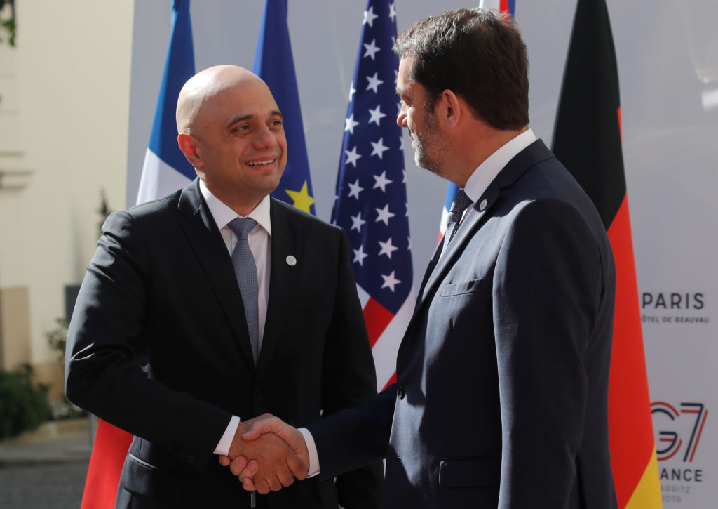 French Interior Minister Christophe Castaner greets Britain's Home Secretary Sajid Javid as part of the Interior ministers...