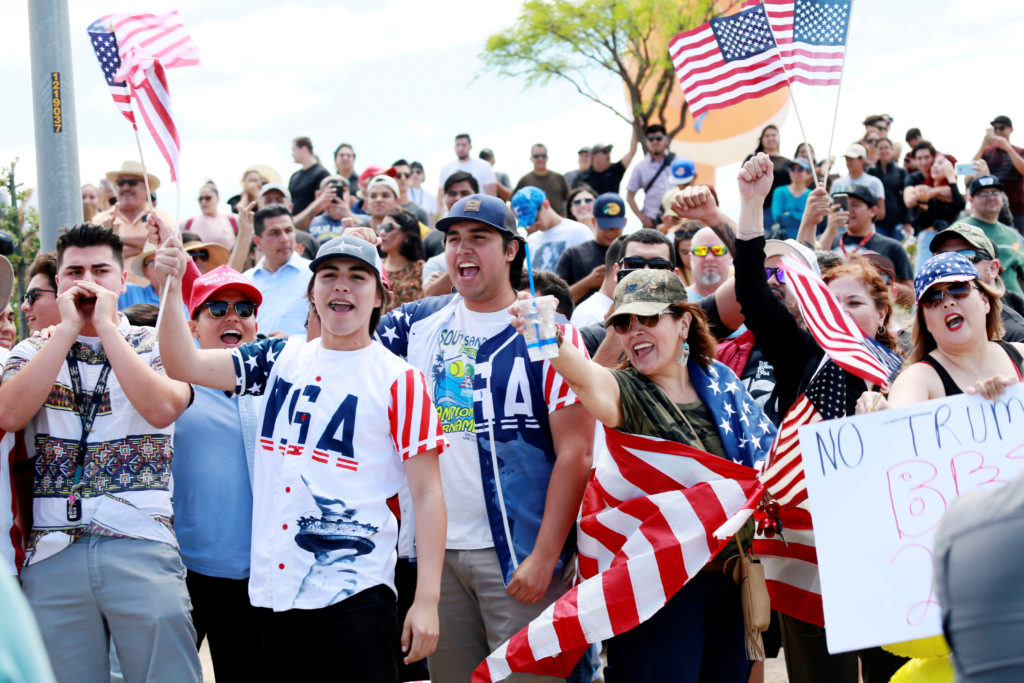 Supporters of U.S. President Donald Trumpcheer during a rally as Trump visits the U.S.-Mexico border in Calexico, California, U.S., April 5, 2019. Photo by Sandy Huffaker/Reuters